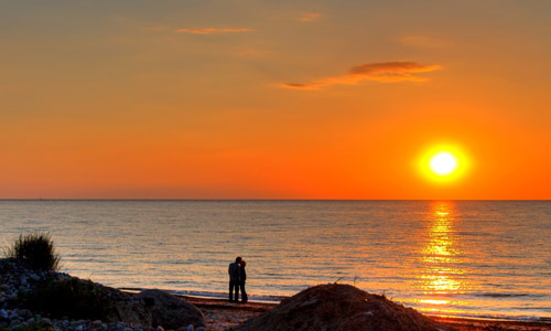 100 Ways To Be Romantic - Watch The Sun Setting Together.