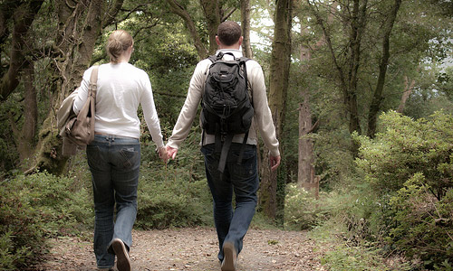 50 Fun Date Ideas - Walk together holding each others hands.