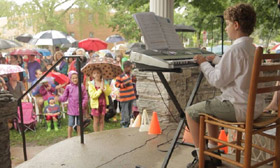 Hundreds Of Strangers Stood In The Rain To Encourage This 8-Year Old For His Piano Concert