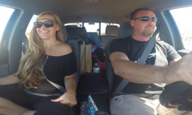 This Couple Does A Super Sign Language Version Of 'You're The One That I Want' While Driving